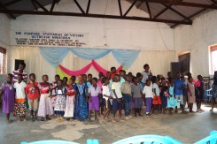 The children at a school performing a welcome song for our team