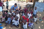 Paul, one of our team members with children from a school